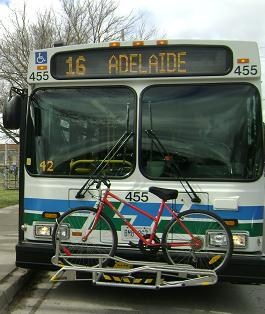 Bike stored on the front of a bus bike rack
